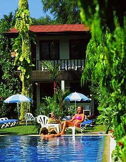 The Swimming pool at K-Hotel set in a tropical garden